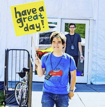 Me holding a picket sign wishing people to have a great day!